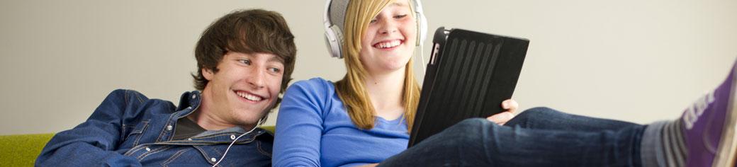 Man Women Laptop relaxing on Sofa - UTStarcom